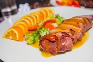 peito de pato com molho tangerina foto