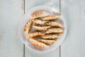 vista superior, asiático, aperitivo, panela, frito, bolinhos foto