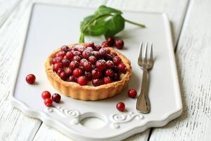torta com cranberries e queijo mascarpone foto