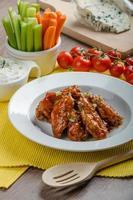 asas de frango quente foto