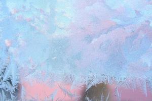 geada na janela de inverno foto