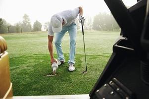 divot reparação de golfe foto