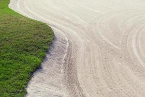 campo de golfe e areia foto