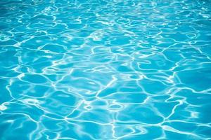 fundo azul da superfície da piscina foto