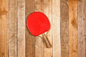 raquete e bola de ping pong foto