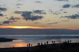 fogo do sol da praia foto