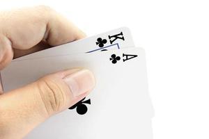 cartão de jack preto de clubes na mão foto