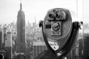 Empire State Building e binóculos foto