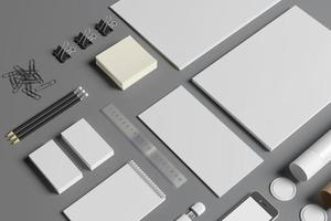 artigos de papelaria em branco isolados em cinza