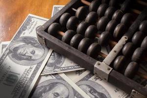 ábaco com dinheiro foto