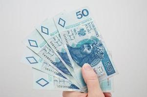 polonês dinheiro na mão foto