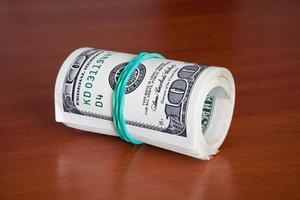 conceitos de negócios - dólares em dinheiro foto