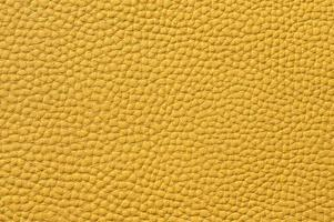 closeup de textura de couro amarelo sem costura foto