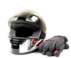 capacete e luva de motocicleta foto