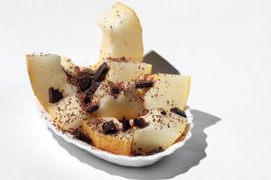 sobremesa de melão com chocolate foto
