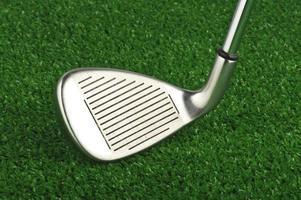 clube de ferro de golfe foto