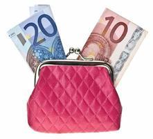 bolsa de moedas com dinheiro foto