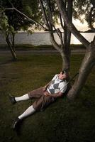 jogador de golfe cansado tirando uma soneca. foto