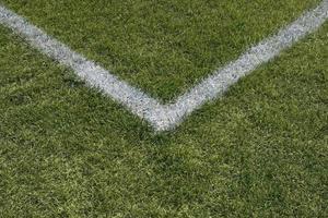 linhas de limite de canto de um campo de esportes foto