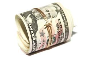 notas de dólar roladas foto