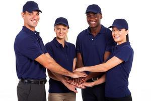 equipe de serviço mãos juntas foto