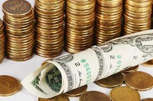 macro de pilha de dinheiro ouro foto