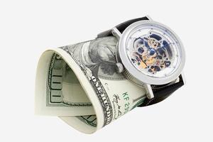 relógio e dinheiro close-up. tempo é dinheiro conceito foto