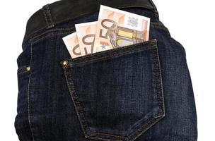 jeans dinheiro no seu bolso foto