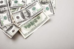 dinheiro americano cem notas de dólar foto