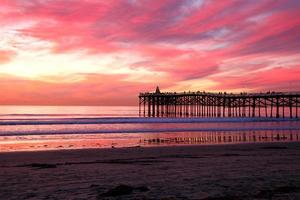 pôr do sol praia rosa foto