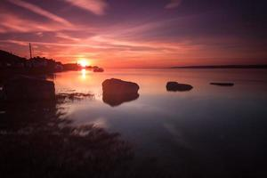 pôr do sol do estuário de loughor foto