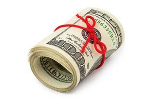 rolo de dinheiro e arco foto