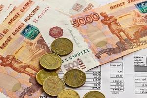 pagamento de serviços públicos e dinheiro foto