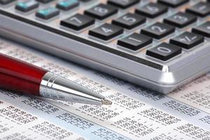 calculadora e caneta foto