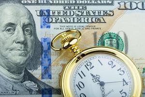 cem dólares, tempo é dinheiro foto