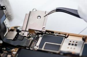 processo de reparo do telefone móvel foto