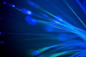 fundo de tecnologia turva abstrata de fibras ópticas foto
