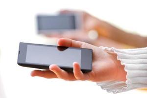 telefone móvel esperto na mão foto