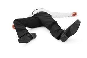empresário deitado inconsciente foto