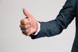 mão de empresário aparecendo polegar foto