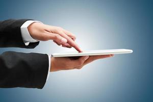 mão do empresário toque tablet, conceito do negócio foto