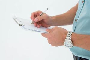 entregador, escrevendo na área de transferência foto