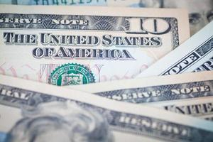 as notas de dólar para o conceito de negócios e finanças