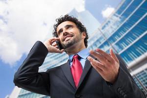 empresário profissional no telefone foto