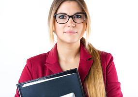garota de negócios jovem, olhando para a câmera. isolado no branco