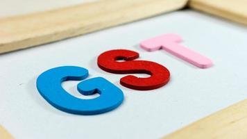letras do alfabeto de imposto sobre bens e serviços e serviços foto