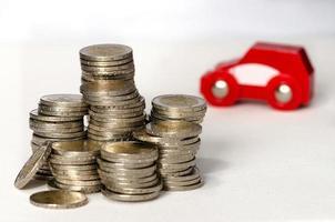 moedas e carro foto
