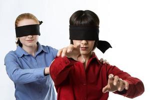 cego guiando cego foto