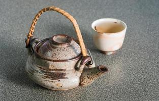 bule de chá com copo foto