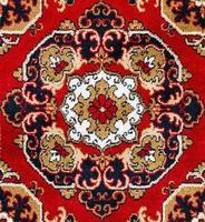 fundo de textura de tapete oriental vermelho foto